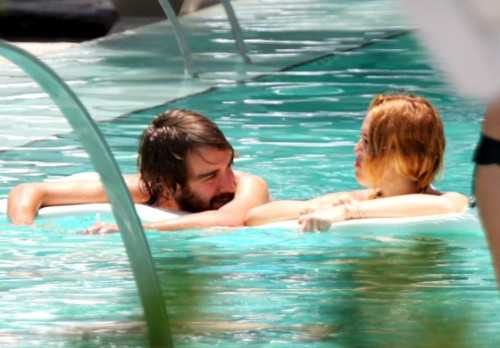 Miley Cyrus and guy in pool - sticky - story - 3