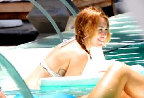 Miley Cyrus and guy in pool - sticky - story - 2