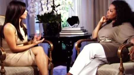 Kim Kardashian and Oprah Interview - holding