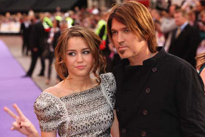 LONDON - APRIL 23:  Actress Miley Cyrus and father Billy Ray Cyrus arrives at the UK film premiere of 'Hannah Montana: The Movie' held at the Odeon, Leicester Square on April 23, 2009 in London, England.  (Photo by Tim Whitby/Getty Images) *** Local Caption *** Miley Cyrus;Billy Ray Cyrus