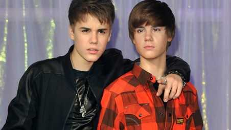 LONDON, ENGLAND - MARCH 15:  Justin Beiber (L) unveils his waxwork at Madame Tussuds on March 15, 2011 in London, England.  (Photo by Gareth Cattermole/Getty Imagesa)