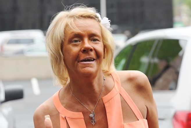 The tanning Mom Patricia Krentcil arrives to an office in New Jersey