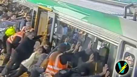 commuters lift train video help free trapped passenger perth australia