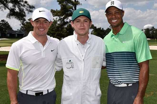 Wrong Direction! Niall Horan Slips Over Caddying For Rory McIlroy