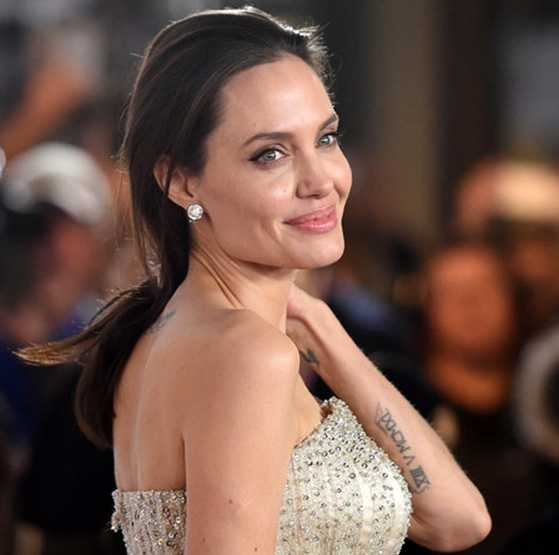 angelina jolie defaces entire upper back with new buddhist