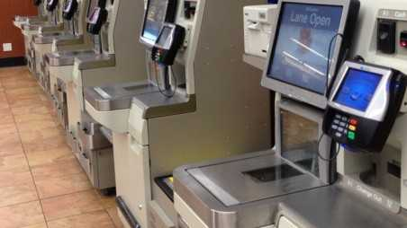 man scans genitals on self service checkout